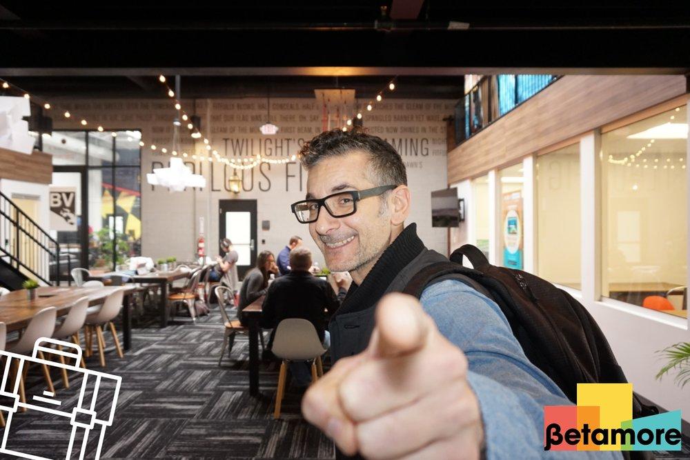 PixiCloud photo of a man at Betamore at City Garage pointing at the camera.